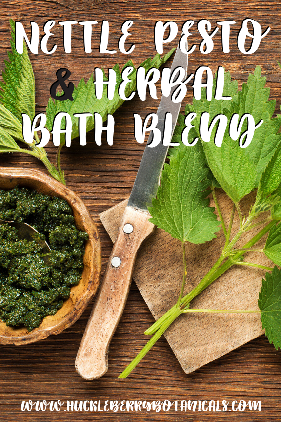 fresh nettles on a wood cutting board with a knife and wooden bowl of pesto