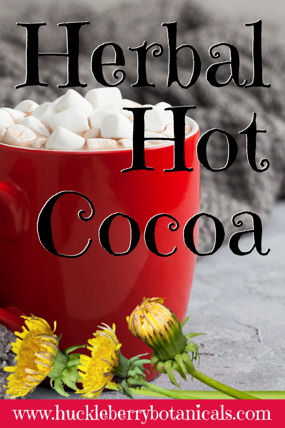 closeup of a red mug of herbal hot cocoa with yellow dandelion flowers