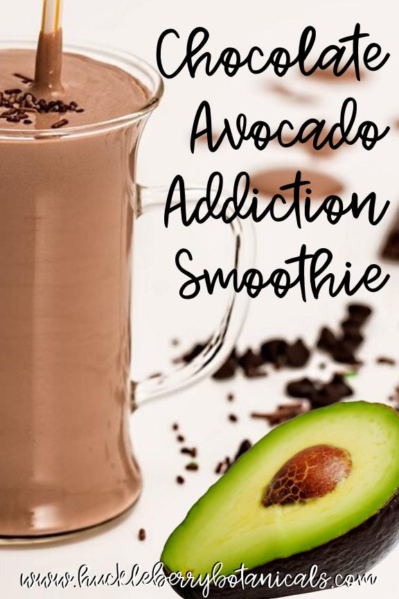 large glass mug of chocolate smoothie with chocolate sprinkles and half of an avocado